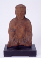 Wooden male god sitting statue